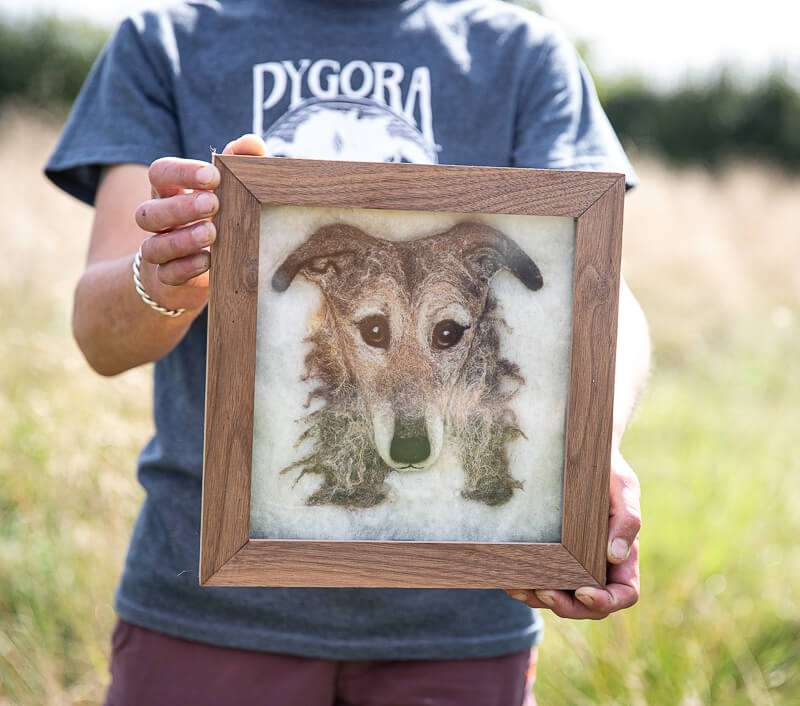 Handmade wool picture of a dogs face in a beech frame